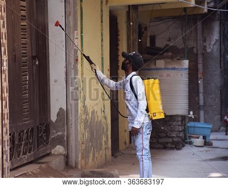 Delhi - India 28th April 2020 An Indian Municipal Corporation Health Worker Sanitize A Residential A