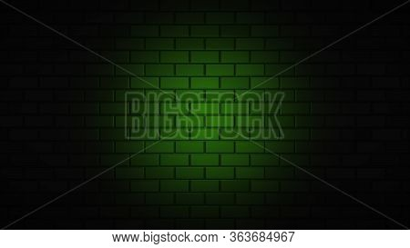 Black Brick Wall With Green Neon Light With Copy Space. Lighting Effect Green Color Glow On Brick Wa