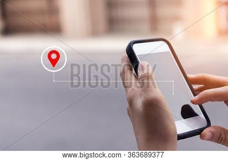 Woman Hand Using Smart Phone With Navigator Location Point At Street Background. Technology Interene