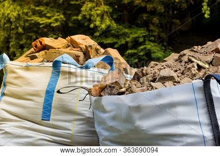 Wastes From The Production Or Renovation. Two Big Bags Container With Rubble.