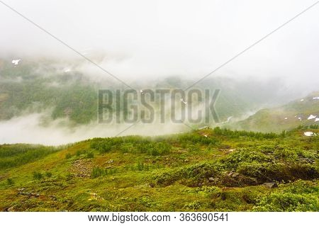 Norwegian Scenic Mountains Landscape In Summer Hazy Rainy Day, Hiking Area Between Aurland And Laerd