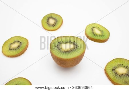 Juicy Kiwifruit Half And Cut Slices Closeup Isolated On White Background. Organic Food Or Healthy Nu
