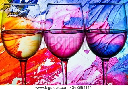 Three Wine Glasses In A Row With Colorful Light Painting Behind, Set Of Three Wine Glasses With Red,