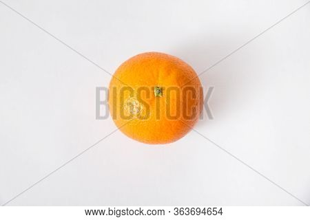 Top View Of Whole Orange Fruit Isolated On White Background. Single Object, Closeup. Natural Vitamin