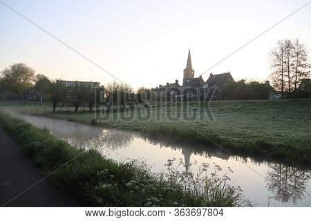 Morning Mist Over The Meadows And Ditches At The Mound Of The Old Village Of Nieuwerkerk Aan Den Ijs