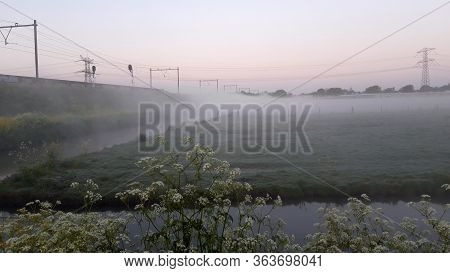 Sunrise With Morning Fog Over The Meadows And Ditches In The Groene Zoom Between Nieuwerkerk Aan Den