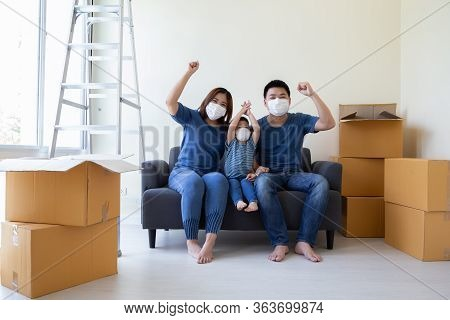 Asian Family Wearing Protective Medical Mask For Prevent Virus Covid-19 And Hand Up During Moving Da