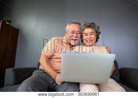Asian Senior Couple Talking In Video Call Chat On Laptop Computer, Smart Technology For Old Age And