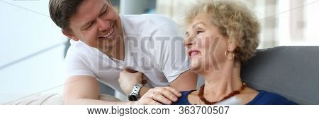 Portrait Of Happy Cheerful Relatives Smiling At Home. Smiling Adult Man Having Fun With Aged Mom. Ch