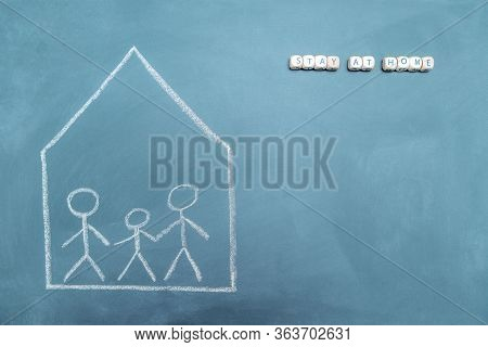 Confined Family Drawn On A Blackboard With The Message Stay At Home, Concept Of Quarantine With Chil