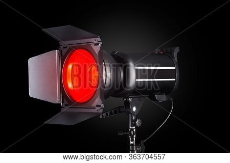 Photography Studio Flash Isolated On Black Background With Lamp.