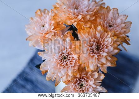 Orange Dahlias Flowers In Vase. Flower In Vase On Table. Flowers For Postcard And Home Decoration. B