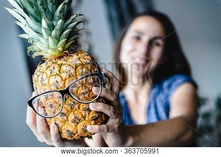 Orange Dahlias Flowers In Vase. Funny Creative Portrait Of Woman Holding Pineapple. Healthy Lifestyl