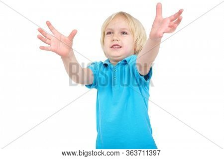 Boy stretched his arms up desperately making reaching for something