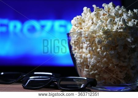 Glass Bowl Of Popcorn And 3d Glasses In The Background A Tv Is Running. In The Evening, We Watch Mov