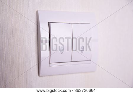 Two-key Switch Gray On The Wall A Plastic Mechanical Switch. Light Switch Installed After Repair. Th