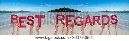 People Hands Holding Word Best Regard, Ocean Background