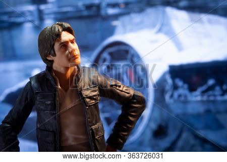 APRIL 27 2020: Recreation of a scene from Star Wars The Empire Strikes Back with Han Solo in a Rebel base hanger with the Mellenium Falcon - Hasbro action figure