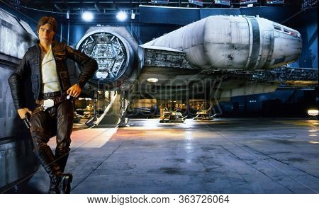 APRIL 27 2020: Scene from Star Wars with Han Solo posing in front of the Mellenium Falcon - Hasbro action figure