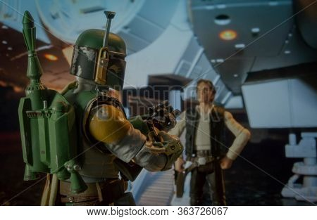 APRIL 27 2020: Scene from Star Wars with Han Solo confronted by bounty hunter Boba Fette at the Mellenium Falcon - Hasbro action figure