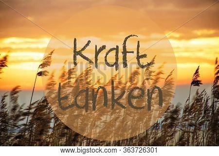 Beach Grass At Sunrise Or Sunset, Text Kraft Tanken Means Relax