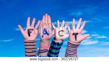 Children Hands Building Word Fact, Blue Sky