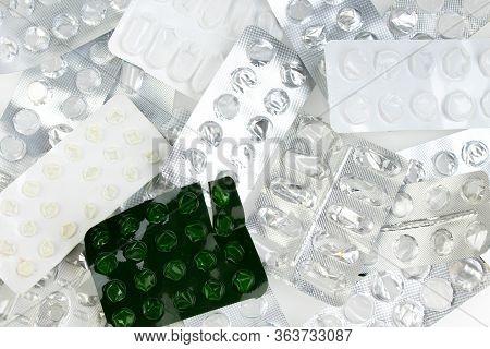 Blister Packings From Pills On A White Background. Empty Bliser. Blister Of Tablets.