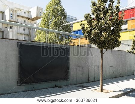 Blank Black Outdoor Horizontal Vinyl Textile Banner At Concrete Wall Of Underground Car Parking. 3d