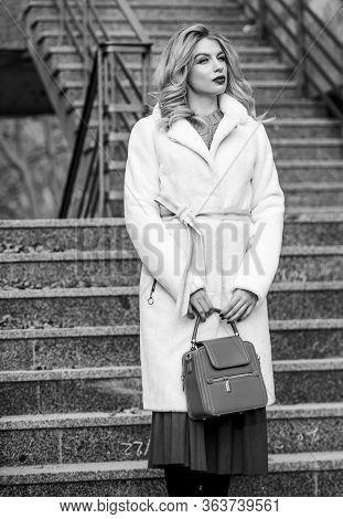 So Nice. European Winter. Girl Warm Coat Stairs Background. Faux Fur Coat Fashion. Stylish Business