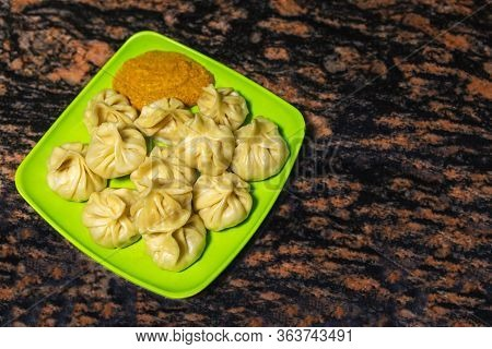 Home Made Traditional Dumpling Momos Food Of Nepal Served On A Plate With Special Momo Sauce. Select
