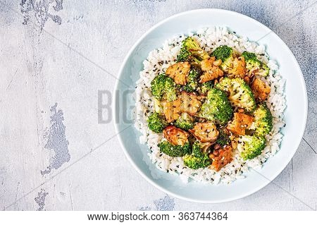 Fried Tempeh With Rice And Broccoli.