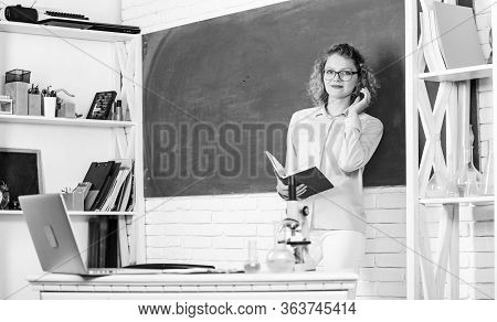 Girl Adorable Teacher In Classroom. Educational Process Concept. Educational Program For Primary Sch