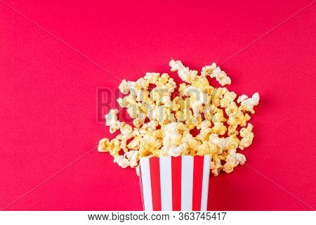 Paper Cup With Popcorn On Color Background. Striped Box With Popcorn On Red Background.popcorn In Re