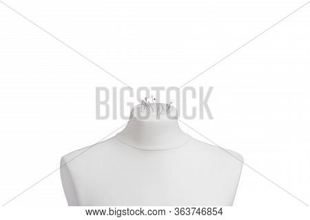 A Mannequin Torso Isolated On A White Background. Mannequin Shoulders With Throwing Needles