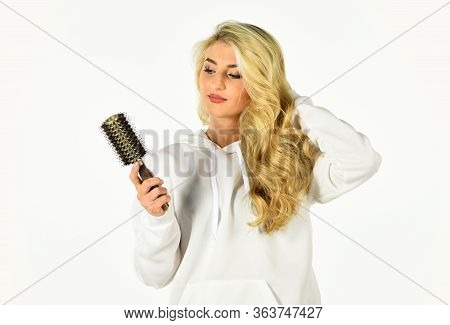 Hairdressing Is Our Passion. Curls Hairstyle. Girl With Long Blonde Blowing Curly Hair. Womens Beaut