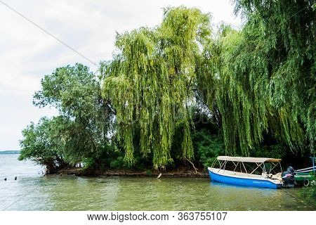 Danube Delta, Romania - August 15, 2019: Beautiful Landscape In Danube Delta, Boats For Sailing At S