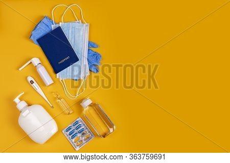 Coronavirus New Lifestyle Concept. Passports, Sanitizer, Thermometer, Medical Gloves, Sanitizer Gel,