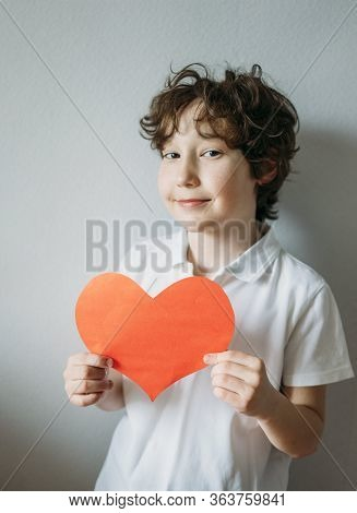 Attractive Curly Hair Tween Boy With Red Heart On Grey Background, Mothers Day