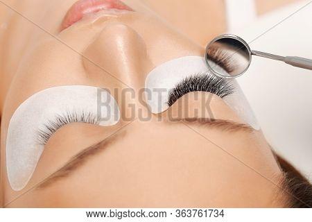 Eyelashes Extensions. Fake Eyelashes. Eyelash Extension Procedure.close Up Portrait Of Woman Eye Wit