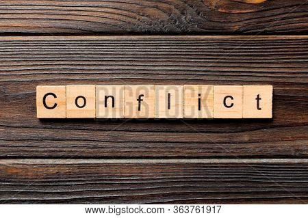 Conflict Word Written On Wood Block. Conflict Text On Wooden Table For Your Desing, Concept