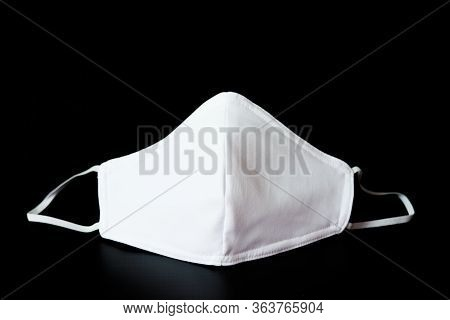 Cloth White Mask Isolated On Black Background - For Prevent Dust (pm 2.5),  Disease (coronavirus Or