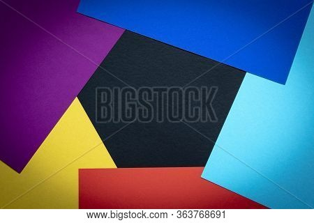 Multi-colored Abstract Geometric Background. Colored Sheets Of Paper On A Dark Background. Trending