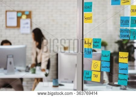 Various Post It Notes Of Business Strategy Wording Over The Glass Wall In Office Or Coworking Space,