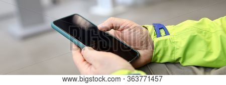 Close-up Male Hands In Jacket Hold Smartphone. Key Features Telephone, Personal Digital Assistant, M