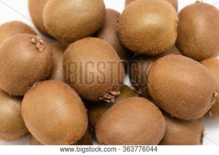 Closeup Of Whole Brown Kiwi Fruits. Top View Of Hairy Fresh Ripe Kiwifruits. Agriculture Or Organic