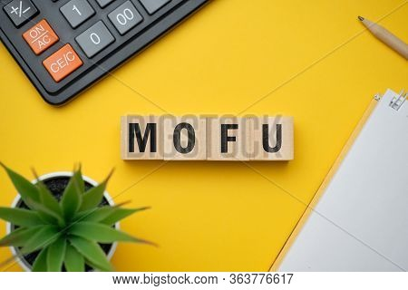 Modern Marketing Buzzword - Mofu Middle Of Funnel. Top View On Wooden Table With Blocks. Top View. C