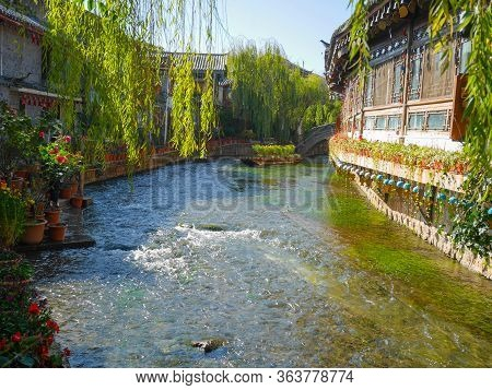 View Of Canal And Garden. Lijiang Is Naxi-style Ancient Town And Famous For Its Unesco Heritage Site