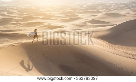 The Girl Runs In The Vast Desert. Freedom Concept. Runs To Freedom To Meet His Dream. Lonely Free Wo