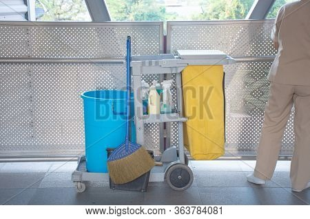 Sanitary Set On Tray With Cleaning Man, Bottle Of Hygiene Liquid With Mop And Bloom And Bin For Clea