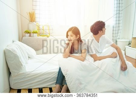 Young Asian Couple In Bed Having Problems And Crisis Man And Woman Hands Cover Head With Confused Un